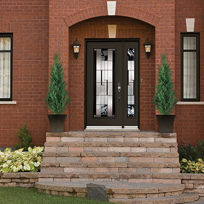 A full glass, chestnut brown entry door
