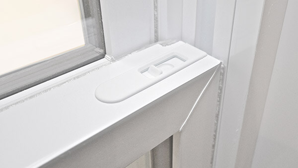 Consumer's Choice double hung windows features an integrated sash latch.