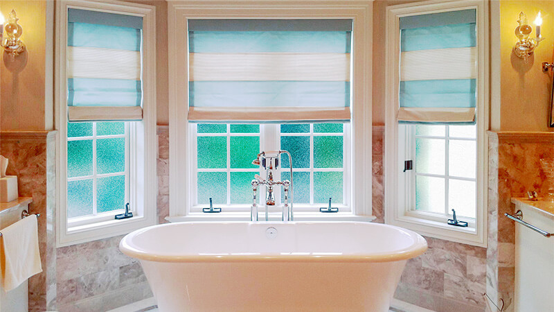 Three replacement casement windows over a gorgeous, modern bathtub.